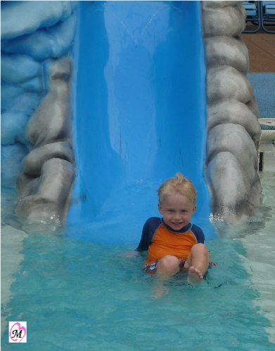 4 year old on water slide