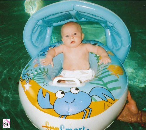 infant in swim raft
